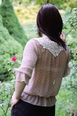 Light viscose blouse in beige with white polka dots and lace neck