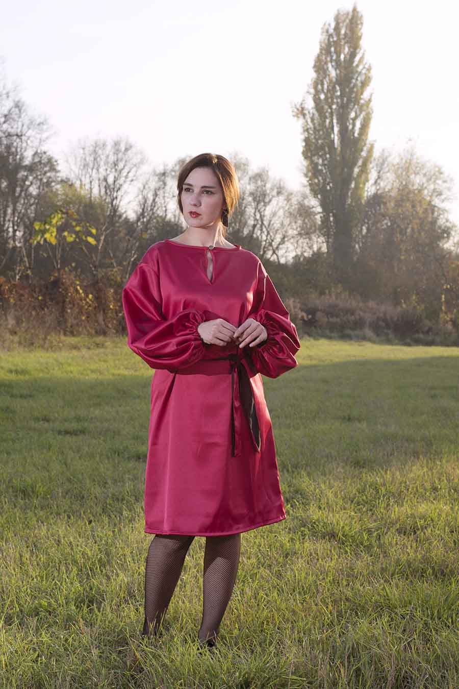Red satin dress with puffy sleeves and belt