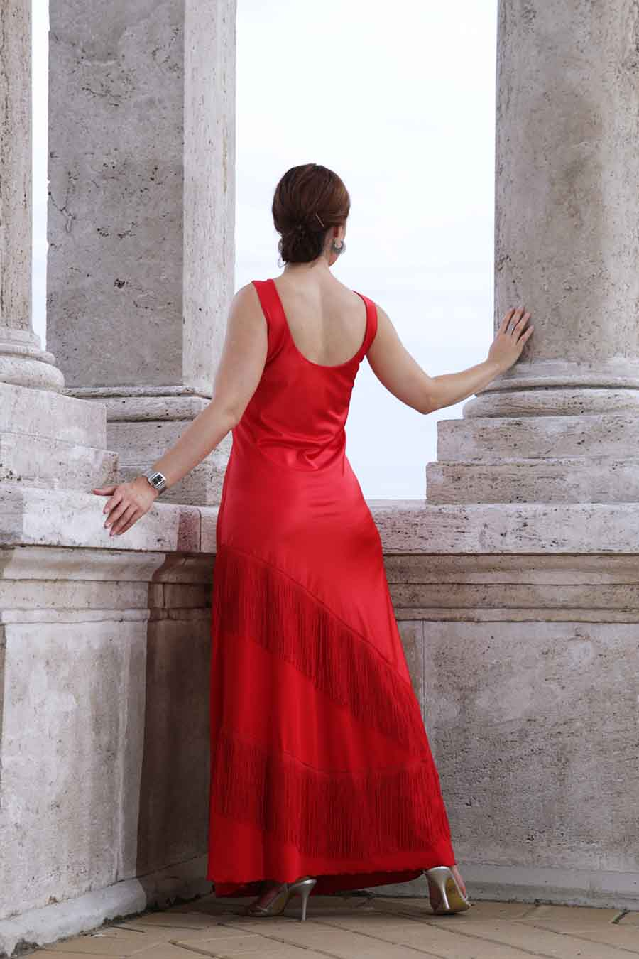 Satin gown in red with fringes from back