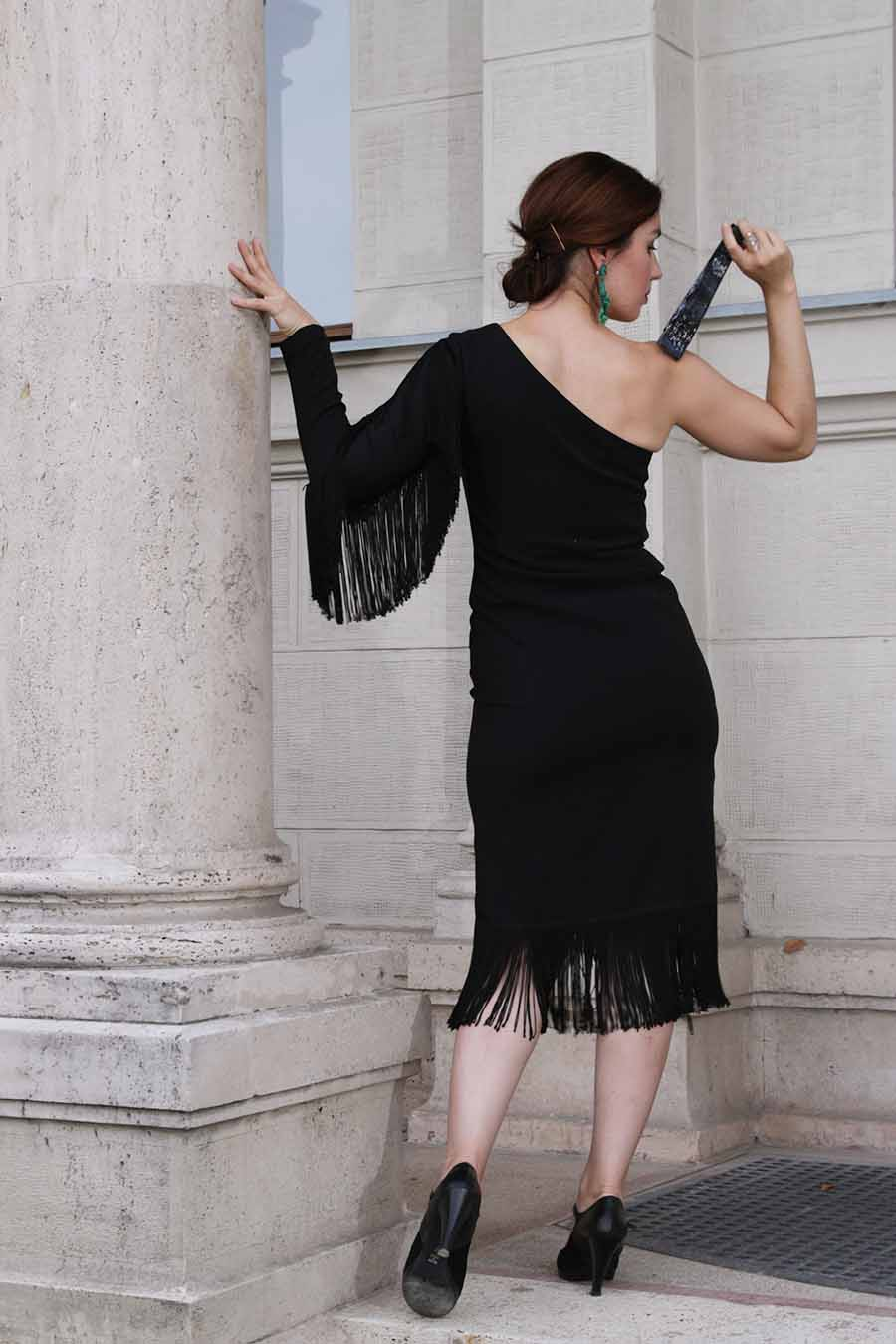 Asymmetric one-sleeve cocktail dress in black with fringes from back
