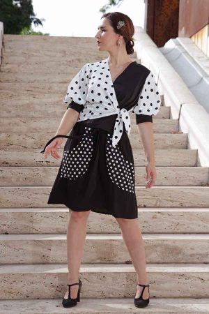 Black A-line skirt with polka dot printed pockets