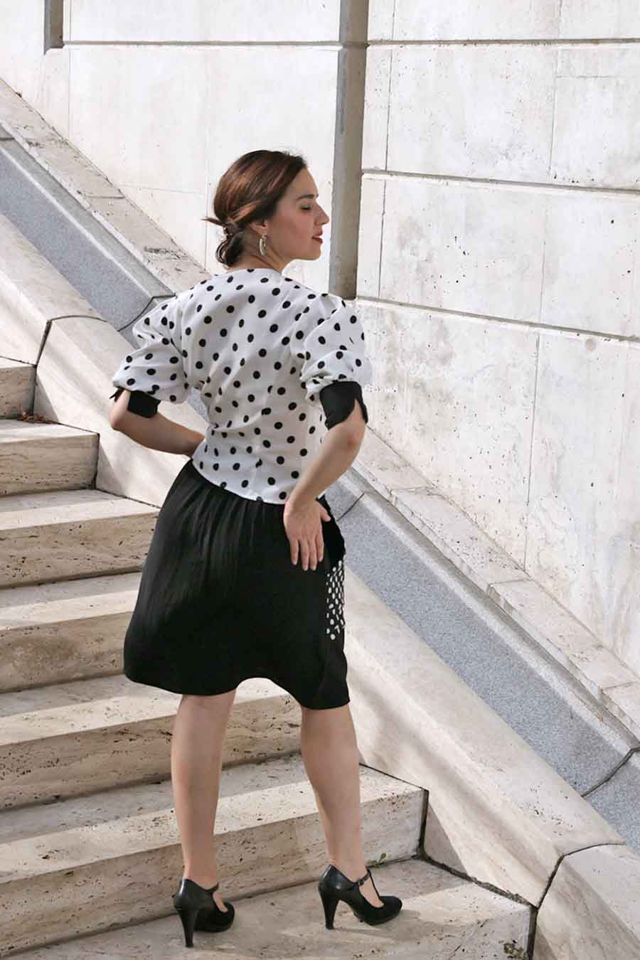 Black A-line skirt with polka dot printed pockets from back