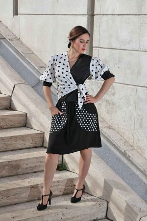 Black and white asymmetric blouse with polka dots