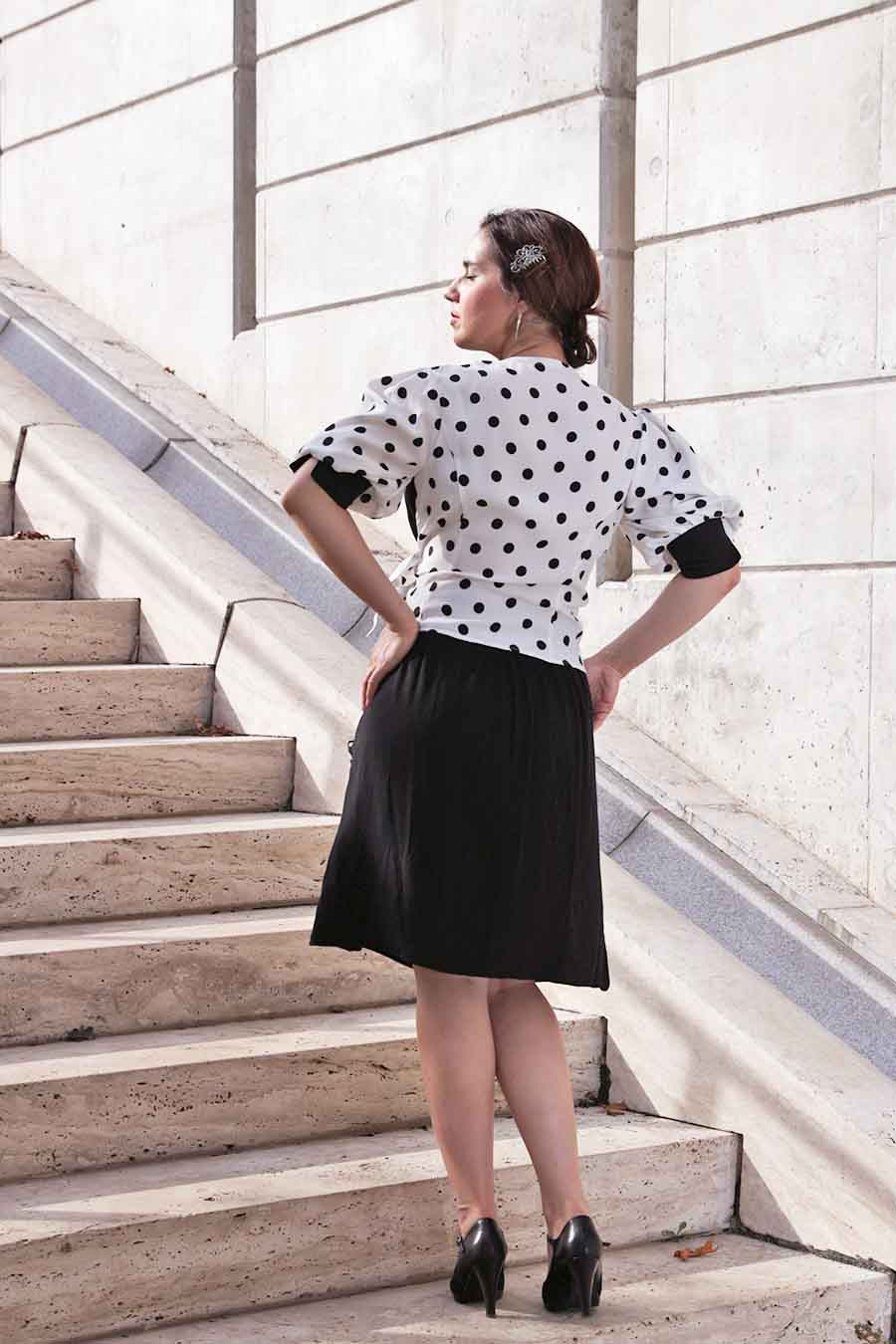 Black and white asymmetric blouse with polka dots from back