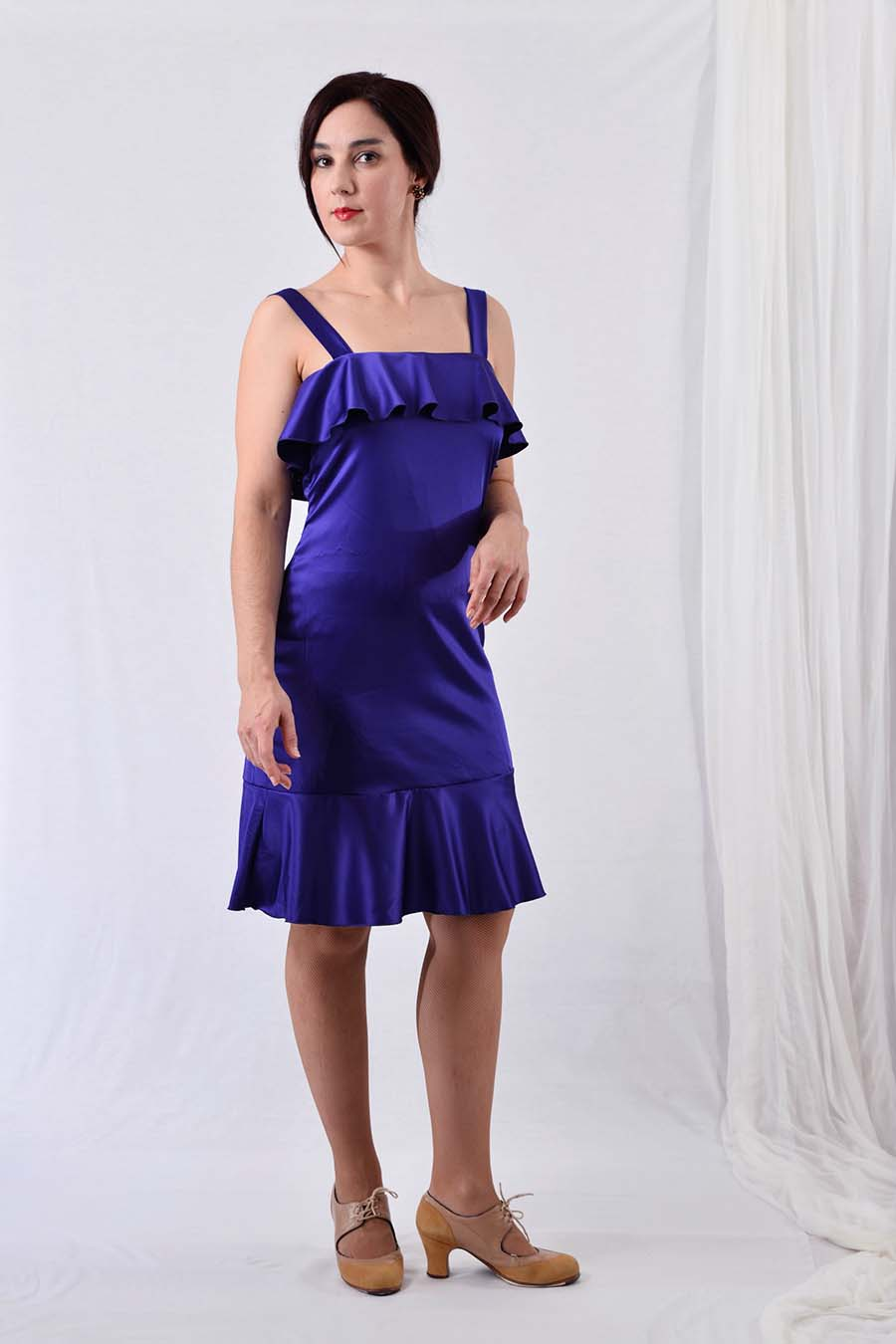 Satin cocktail dress in blue with ruffles