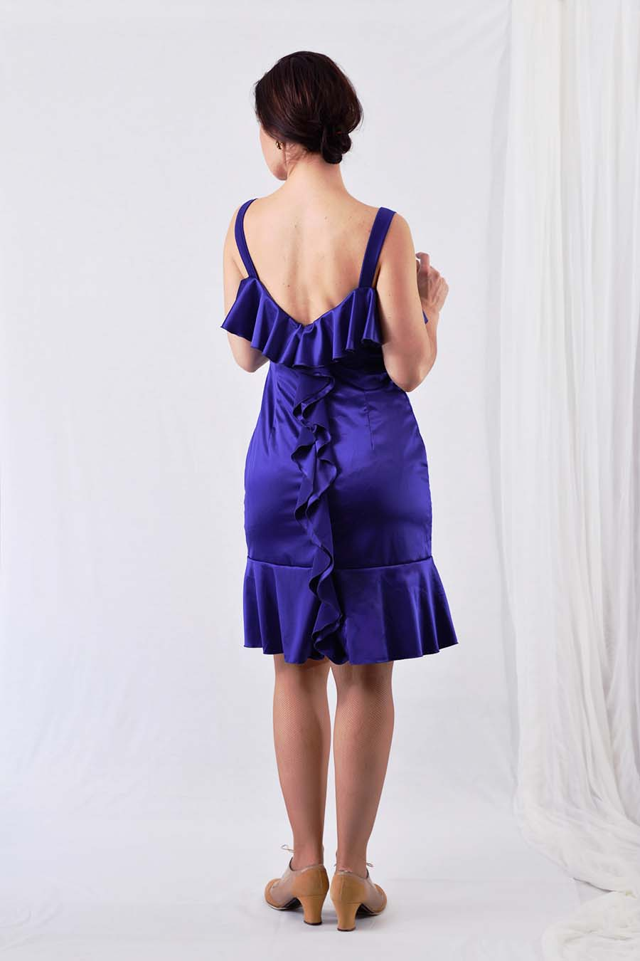 Satin cocktail dress in blue with ruffles from back